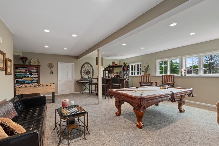 Real Estate Photography - 1063 Sandstone Court, Aurora, IL, 60502 - Lower Level Recreation Room