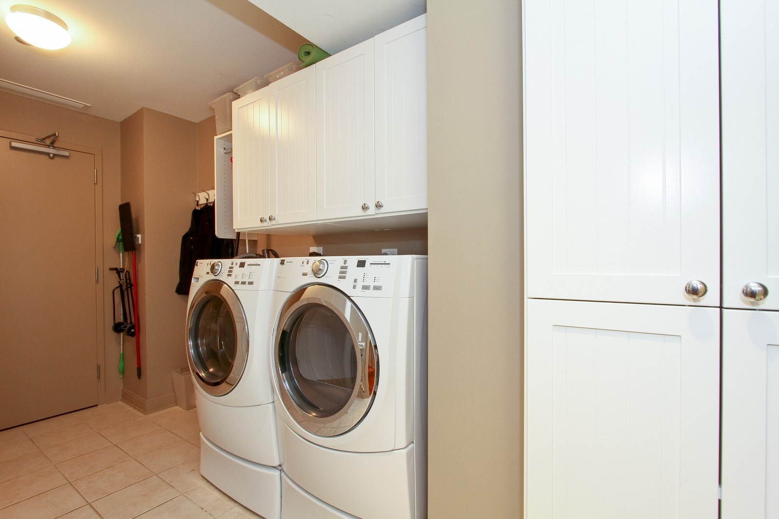 Real Estate Photography - 60 E Monroe, 6501, Chicago, IL, 60603 - Laundry Room