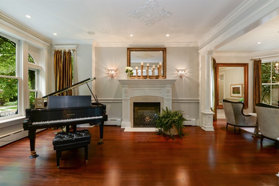 Real Estate Photography - 3440 N Janssen Ave, Chicago, IL, 60657 - Living room with gas fireplace