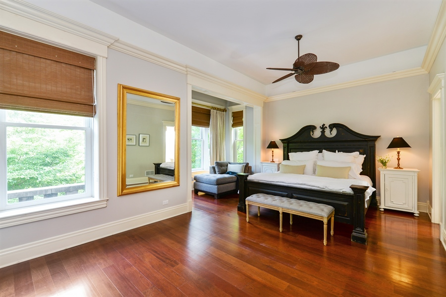 Real Estate Photography - 3440 N Janssen Ave, Chicago, IL, 60657 - Master Bedroom w/ fireplace and built in book case