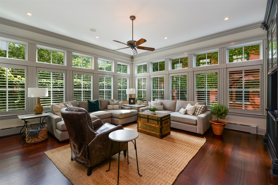Real Estate Photography - 3440 N Janssen Ave, Chicago, IL, 60657 - Family room with custom Kolbe windows