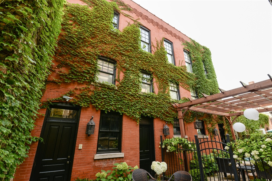 Real Estate Photography - 3440 N Janssen Ave, Chicago, IL, 60657 - Coach house, 3 car garage electric charger station