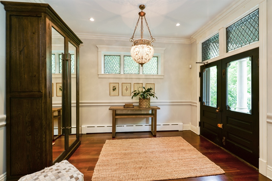 Real Estate Photography - 3440 N Janssen Ave, Chicago, IL, 60657 - Foyer w/ original doors restored and leaded glass