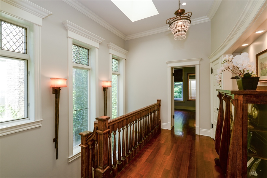 Real Estate Photography - 3440 N Janssen Ave, Chicago, IL, 60657 - 2nd flr landing w/ skylight & leaded glass transom