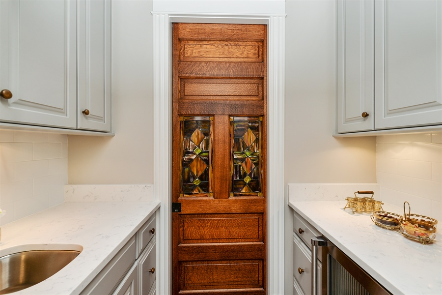 Real Estate Photography - 3440 N Janssen Ave, Chicago, IL, 60657 - Wet Bar w/ Viking wine cooler