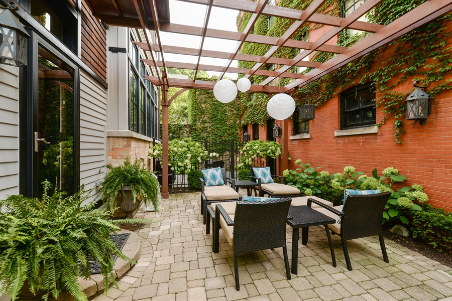 Real Estate Photography - 3440 N Janssen Ave, Chicago, IL, 60657 - Cedar pergola, brick coach house w/ gas lanterns