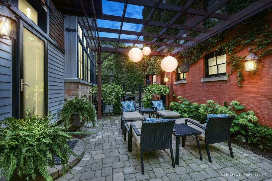 Real Estate Photography - 3440 N Janssen Ave, Chicago, IL, 60657 - Paver patio with cedar pergola & 3 1/2 car garage