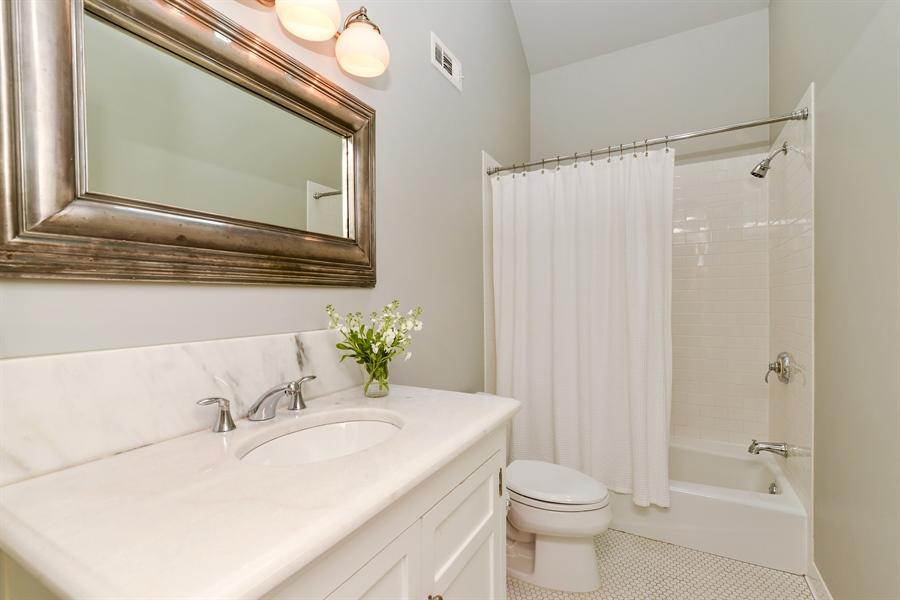Real Estate Photography - 3440 N Janssen Ave, Chicago, IL, 60657 - Ensuite bathroom w/ quartzite vanity top