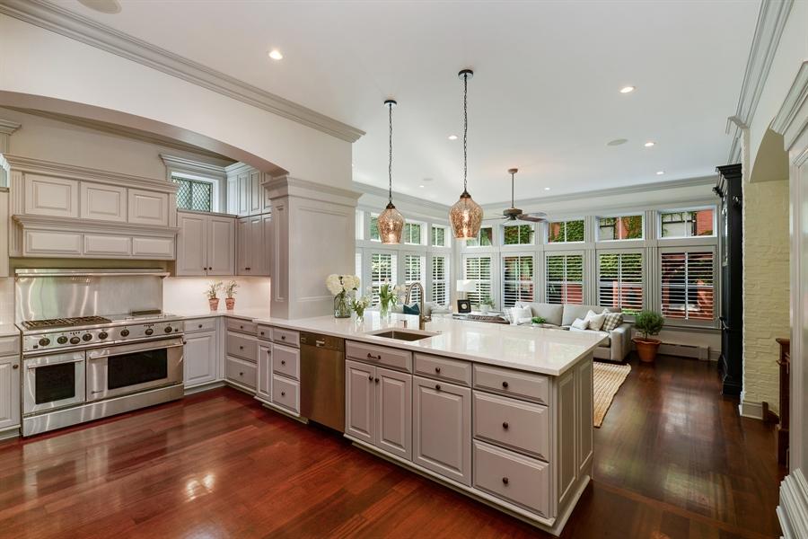 Real Estate Photography - 3440 N Janssen Ave, Chicago, IL, 60657 - Kitchen w/ Sub Zero, Miele and new quartz counter
