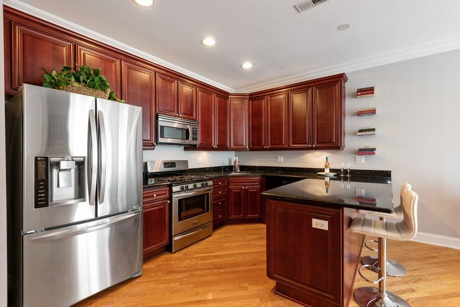 Real Estate Photography - 847 Ridge Ave, Unit 2, Evanston, IL, 60202 - Kitchen