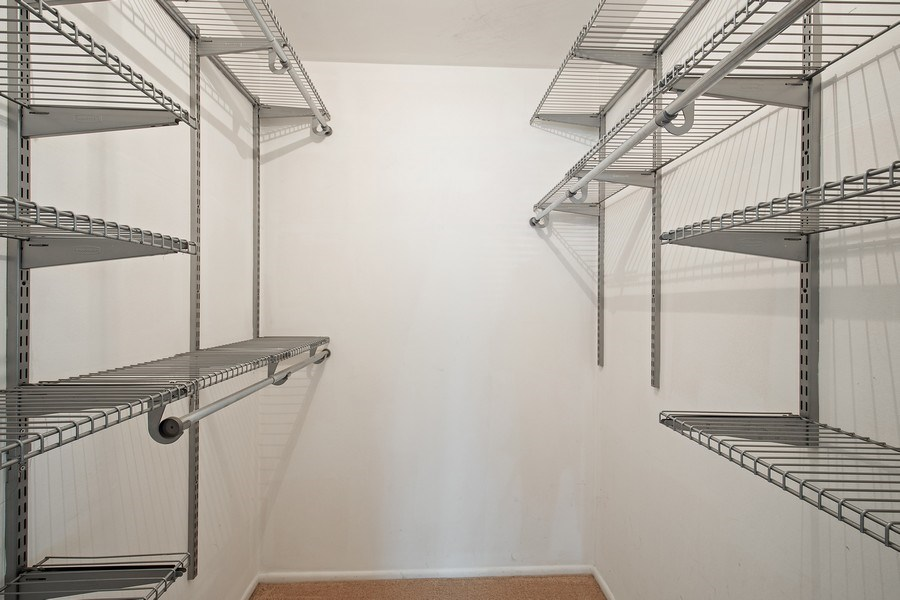 Real Estate Photography - 1180 Northbury Lane #B1, Wheeling, IL, 60090 - Master Bedroom Closet