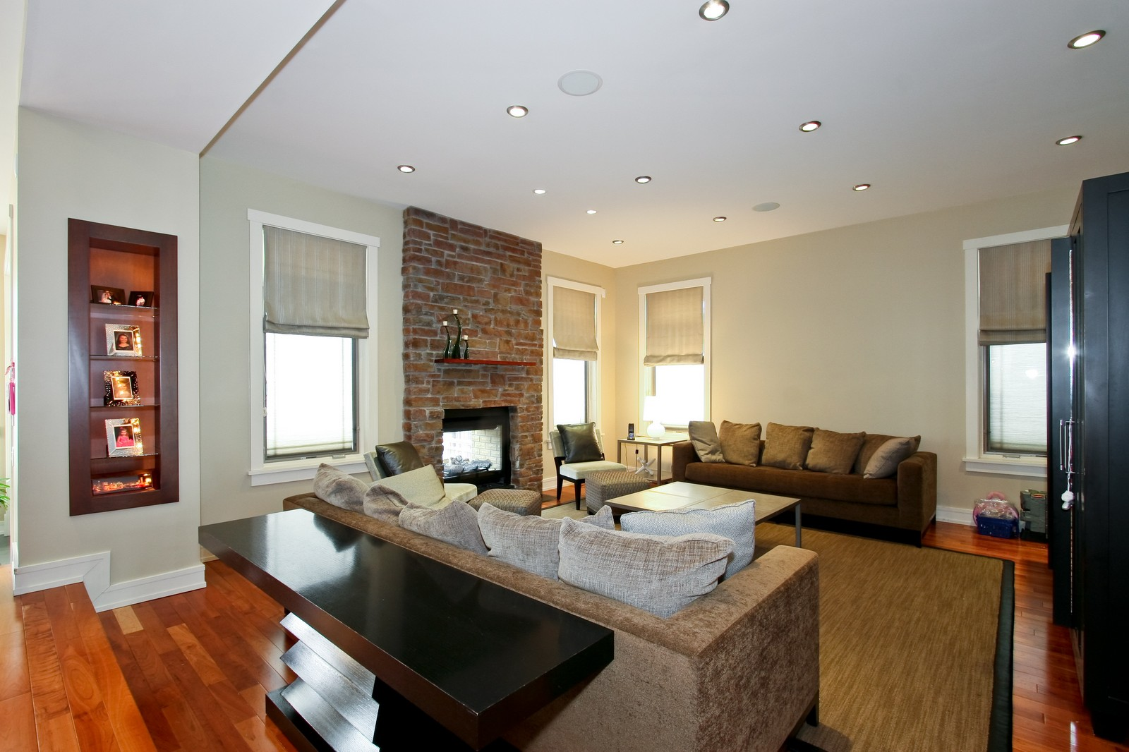 Real Estate Photography - 444 W. 38th Street, Chicago, IL, 60609 - Family Room - double sided fireplace, next to kitc