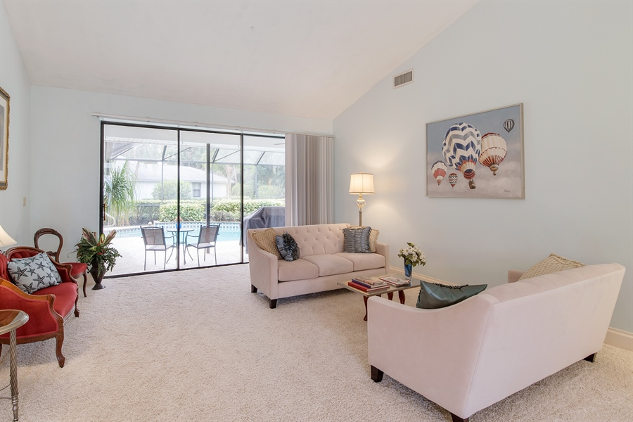 Real Estate Photography - 2211 Imperial Golf Course Blvd, Naples, FL, 34110 - Living Room