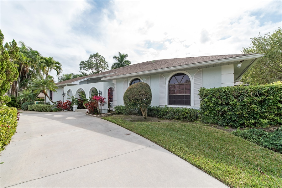 Real Estate Photography - 2211 Imperial Golf Course Blvd, Naples, FL, 34110 - Front View