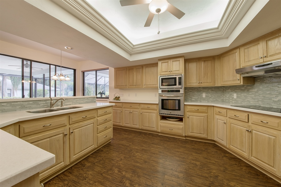 Real Estate Photography - 2211 Imperial Golf Course Blvd, Naples, FL, 34110 - Kitchen