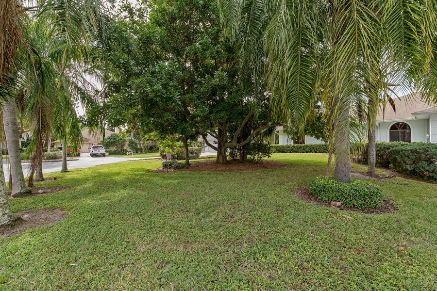 Real Estate Photography - 2211 Imperial Golf Course Blvd, Naples, FL, 34110 - Side View