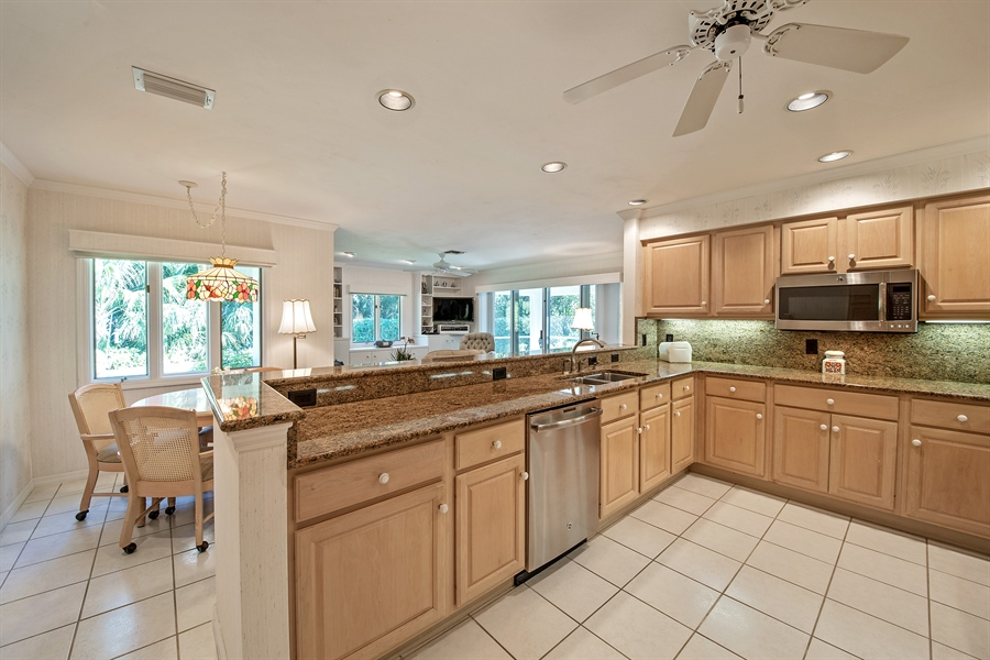Real Estate Photography - 2095 Imperial Circle, Naples, FL, 34110 - Family Room / Kitchen