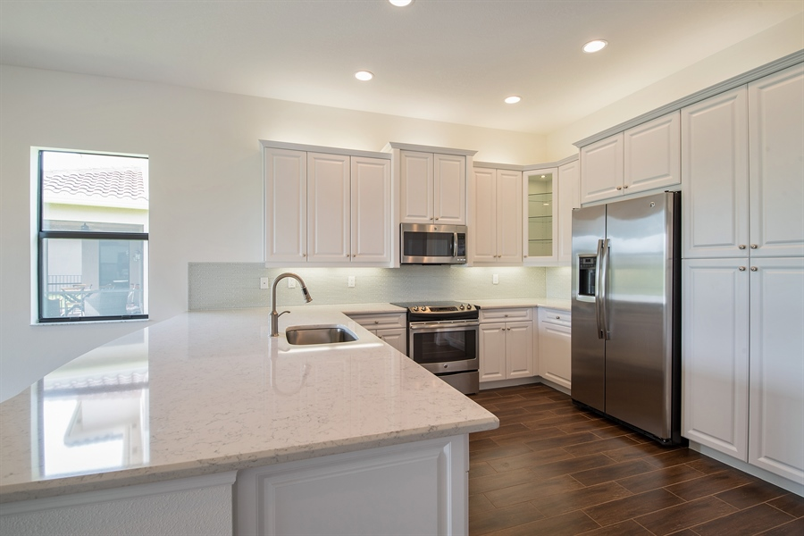 Real Estate Photography - 3510 Sungari Ct, Naples, FL, 34119 - Kitchen