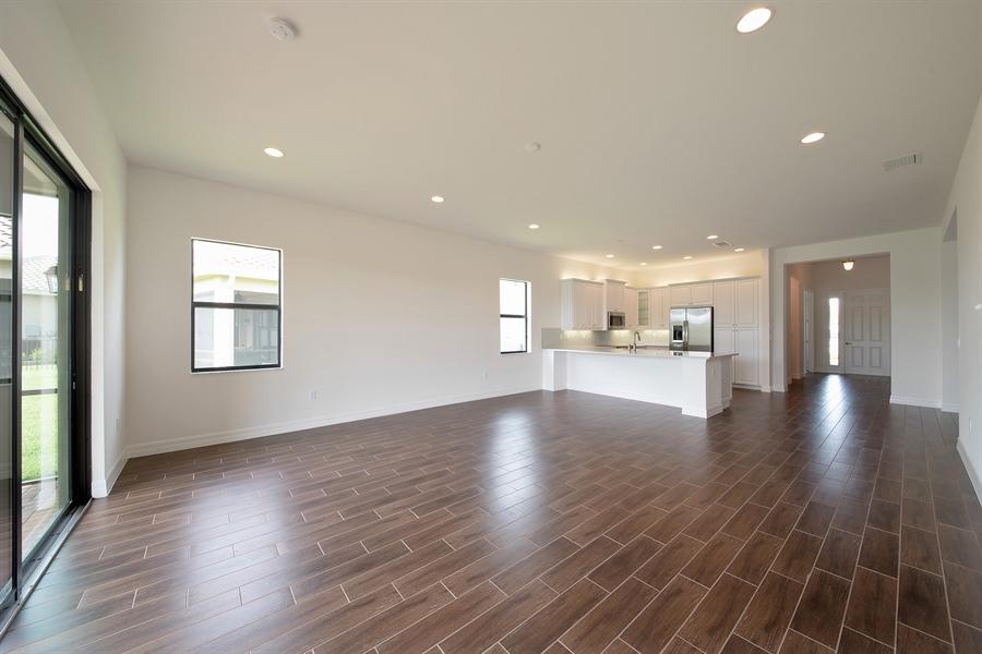 Real Estate Photography - 3510 Sungari Ct, Naples, FL, 34119 - Kitchen / Living Room