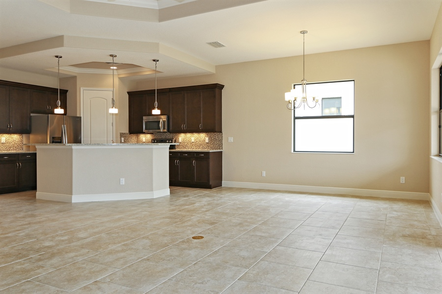 Real Estate Photography - 1509 Serrano Cir, Naples, FL, 34105 - Living Room / Dining Room