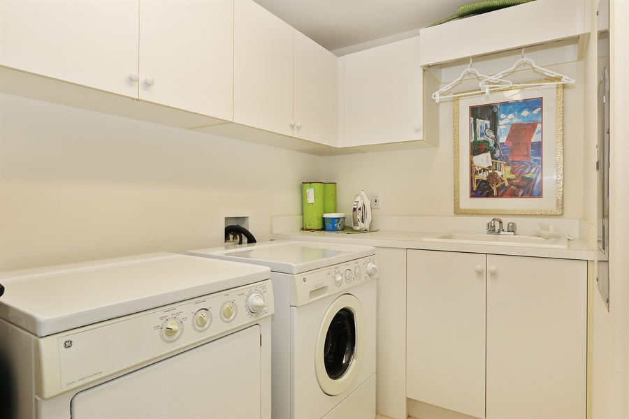 Real Estate Photography - 2738 TIBURON BLVD E, B-204, Naples, FL, 34109 - Laundry Room