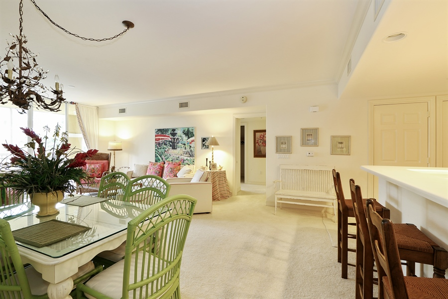 Real Estate Photography - 2738 TIBURON BLVD E, B-204, Naples, FL, 34109 - Living Room / Dining Room