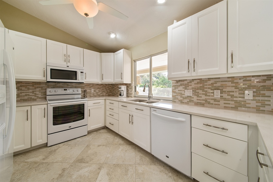 Real Estate Photography - 2666 Outrigger Ln, Naples, FL, 34104 - Kitchen