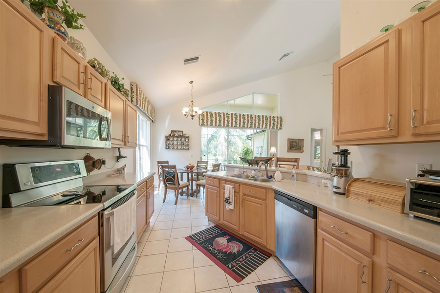 Real Estate Photography - 8829 Ventura Way, Naples, FL, 34109 - Kitchen