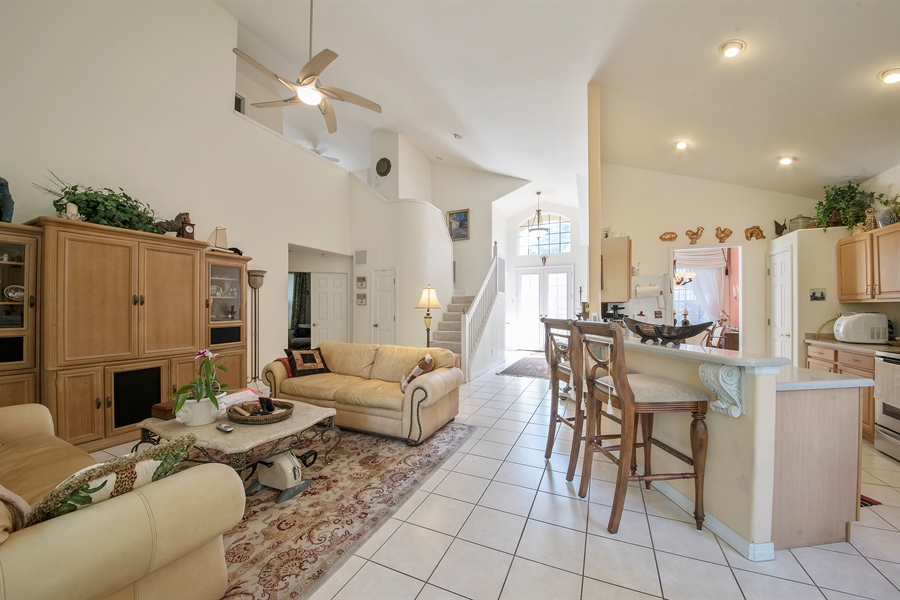 Real Estate Photography - 8829 Ventura Way, Naples, FL, 34109 - Kitchen / Living Room