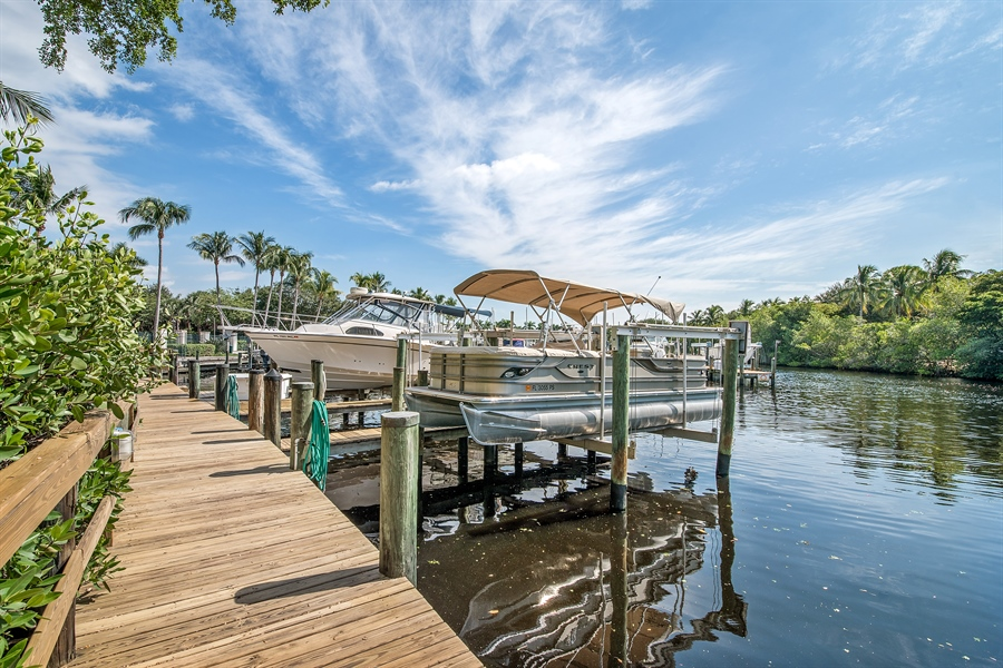 Real Estate Photography - 27640 Marina Isle Ct, Bonita Springs, FL, 34134 - Dock