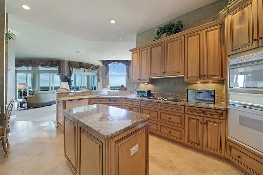 Real Estate Photography - 4801 Island Pond Ct, 1202, Bonita Springs, FL, 34134 - Family Room / Kitchen