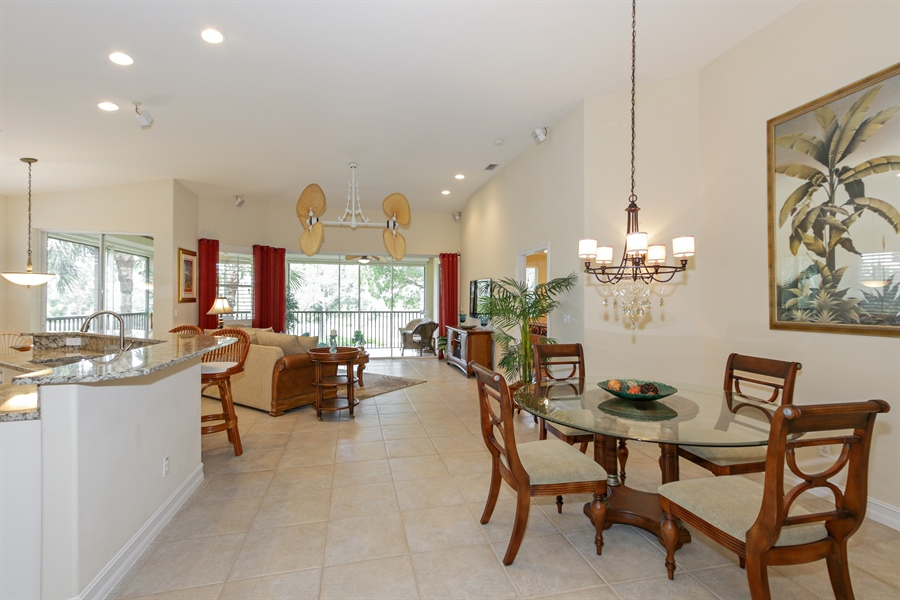Real Estate Photography - 21420 Pelican Sound Dr, 201, Estero, FL, 33928 - Living Room / Dining Room