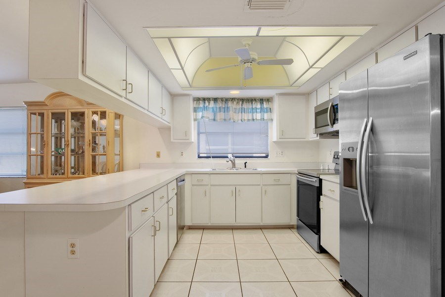 Real Estate Photography - 552 99th Ave N, Naples, FL, 34108 - Kitchen