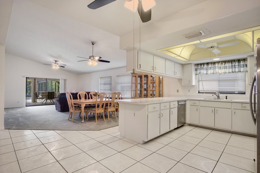 Real Estate Photography - 552 99th Ave N, Naples, FL, 34108 - Kitchen / Living Room