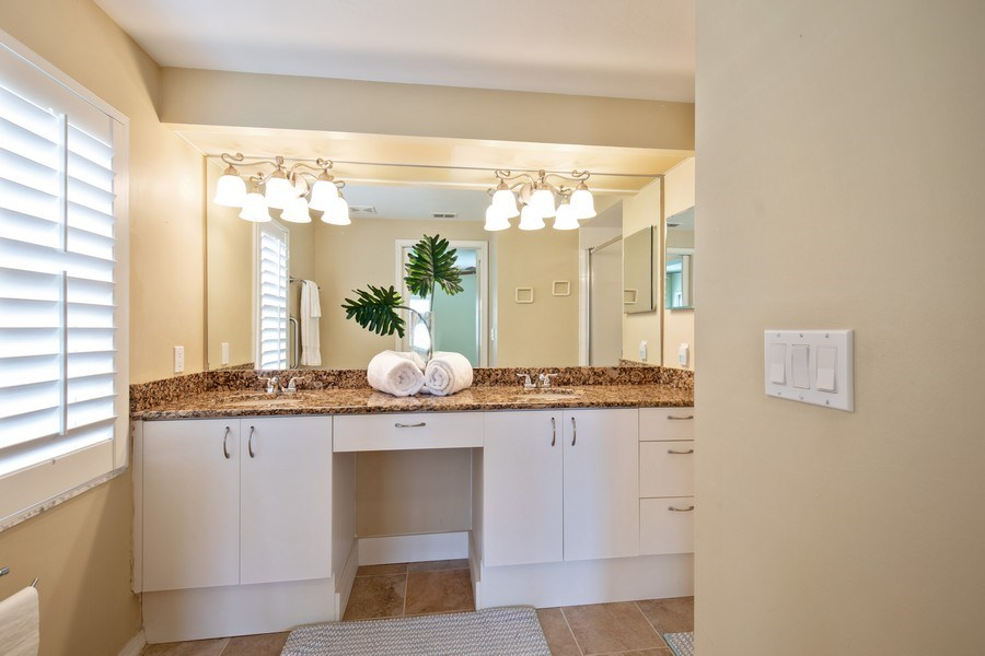 Real Estate Photography - 2506-104 Orchid Bay Drive, Naples, FL, 34109 - Master Bathroom