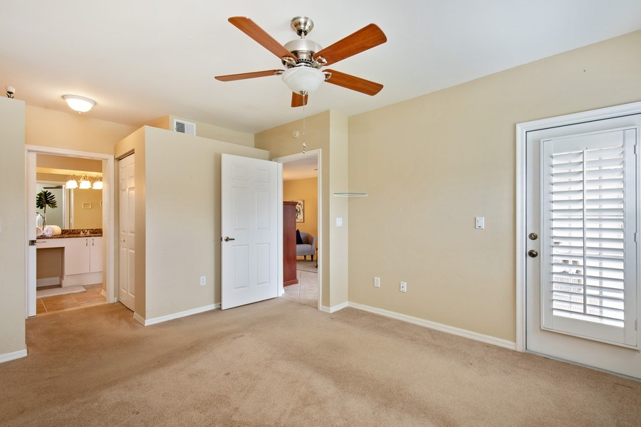 Real Estate Photography - 2506-104 Orchid Bay Drive, Naples, FL, 34109 - Master Bedroom