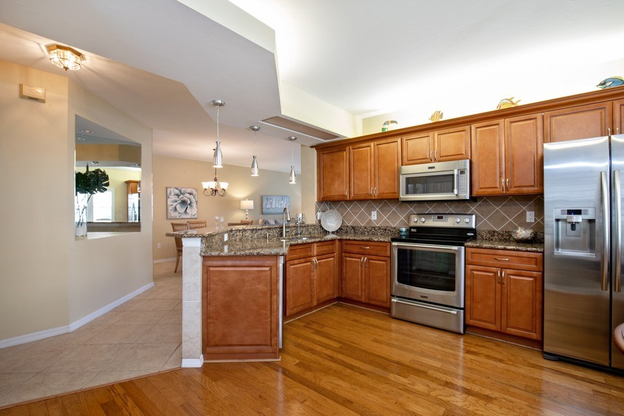 Real Estate Photography - 2506-104 Orchid Bay Drive, Naples, FL, 34109 - Kitchen