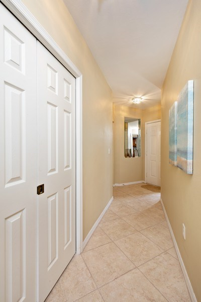 Real Estate Photography - 2506-104 Orchid Bay Drive, Naples, FL, 34109 - Foyer
