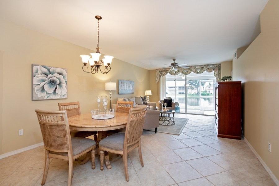 Real Estate Photography - 2506-104 Orchid Bay Drive, Naples, FL, 34109 - Dining Area