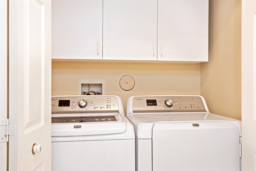Real Estate Photography - 2506-104 Orchid Bay Drive, Naples, FL, 34109 - Laundry Room