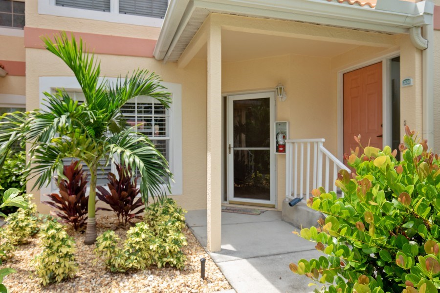 Real Estate Photography - 2506-104 Orchid Bay Drive, Naples, FL, 34109 - Front View