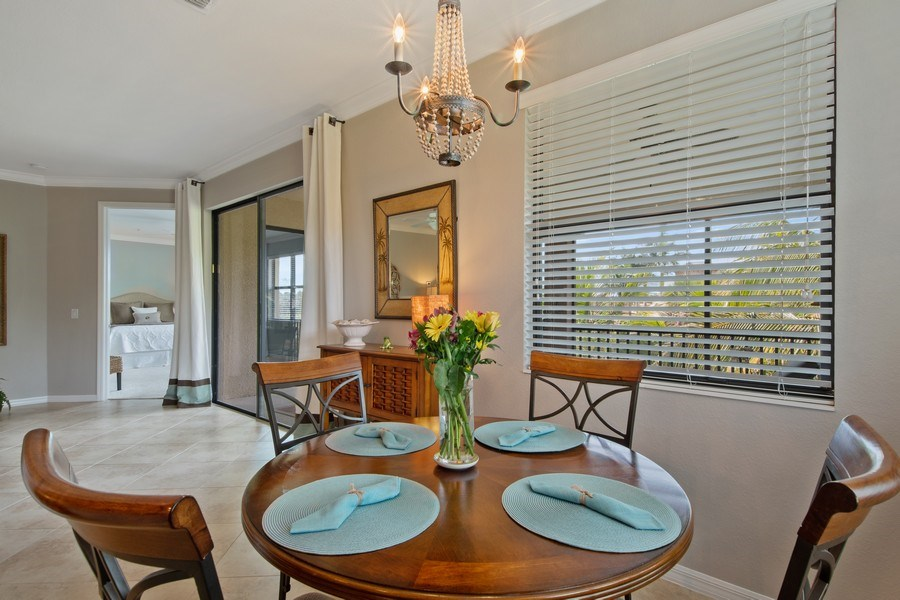 Real Estate Photography - 9127 Nappoli Court, Unit 202, Naples, FL, 34113 - Dining Area 2