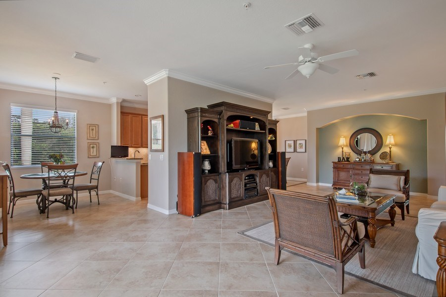 Real Estate Photography - 9127 Nappoli Court, Unit 202, Naples, FL, 34113 - Living Room / Dining Room