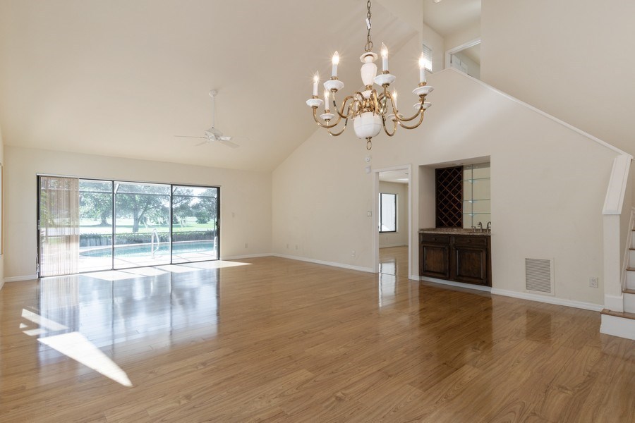 Real Estate Photography - 13242 Wedgefield Drive, Naples, FL, 34110 - Dining/Living Room