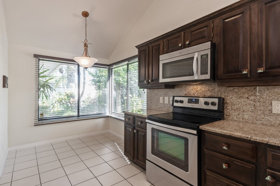 Real Estate Photography - 13242 Wedgefield Drive, Naples, FL, 34110 - Breakfast Nook