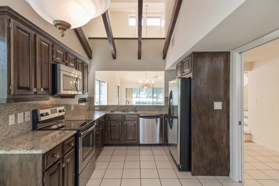Real Estate Photography - 13242 Wedgefield Drive, Naples, FL, 34110 - Kitchen