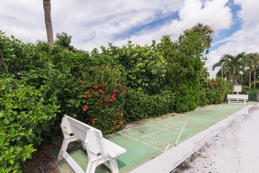 Real Estate Photography - 2064 Alamanda Drive, 24, Naples, FL, 34102 - Shuffelboard