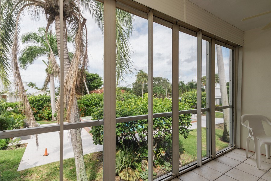 Real Estate Photography - 2064 Alamanda Drive, 24, Naples, FL, 34102 - Screened Lanai