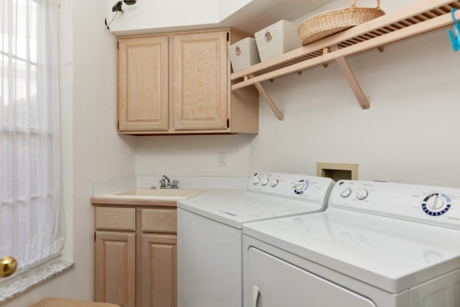 Real Estate Photography - 15283 Devon Green, Naples, FL, 34110 - Laundry Room