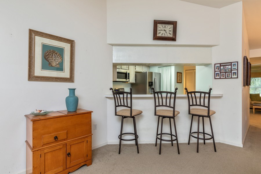 Real Estate Photography - 5895 Chanteclair, Unit 128, Naples, FL, 34108 - Breakfast Area
